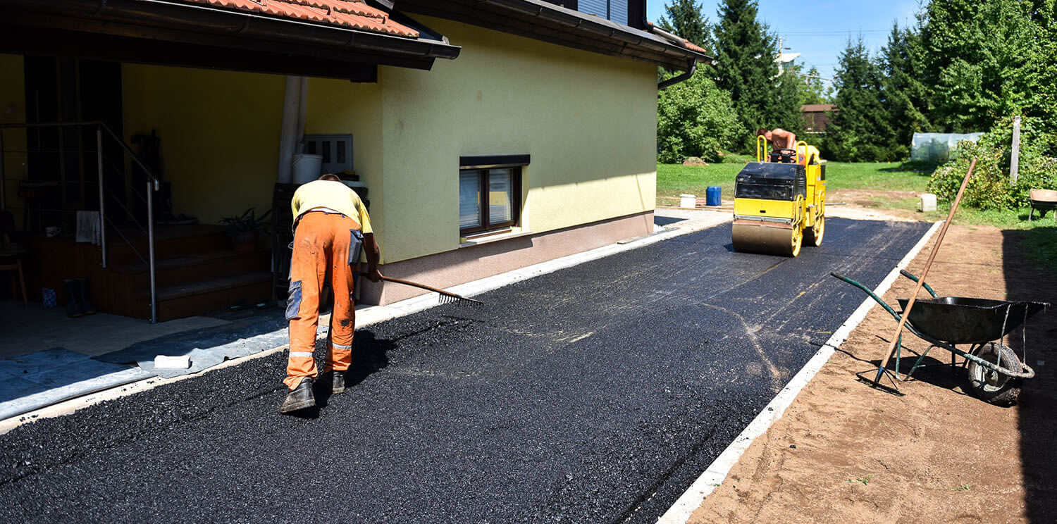 Worker Paving a Residential Driveway