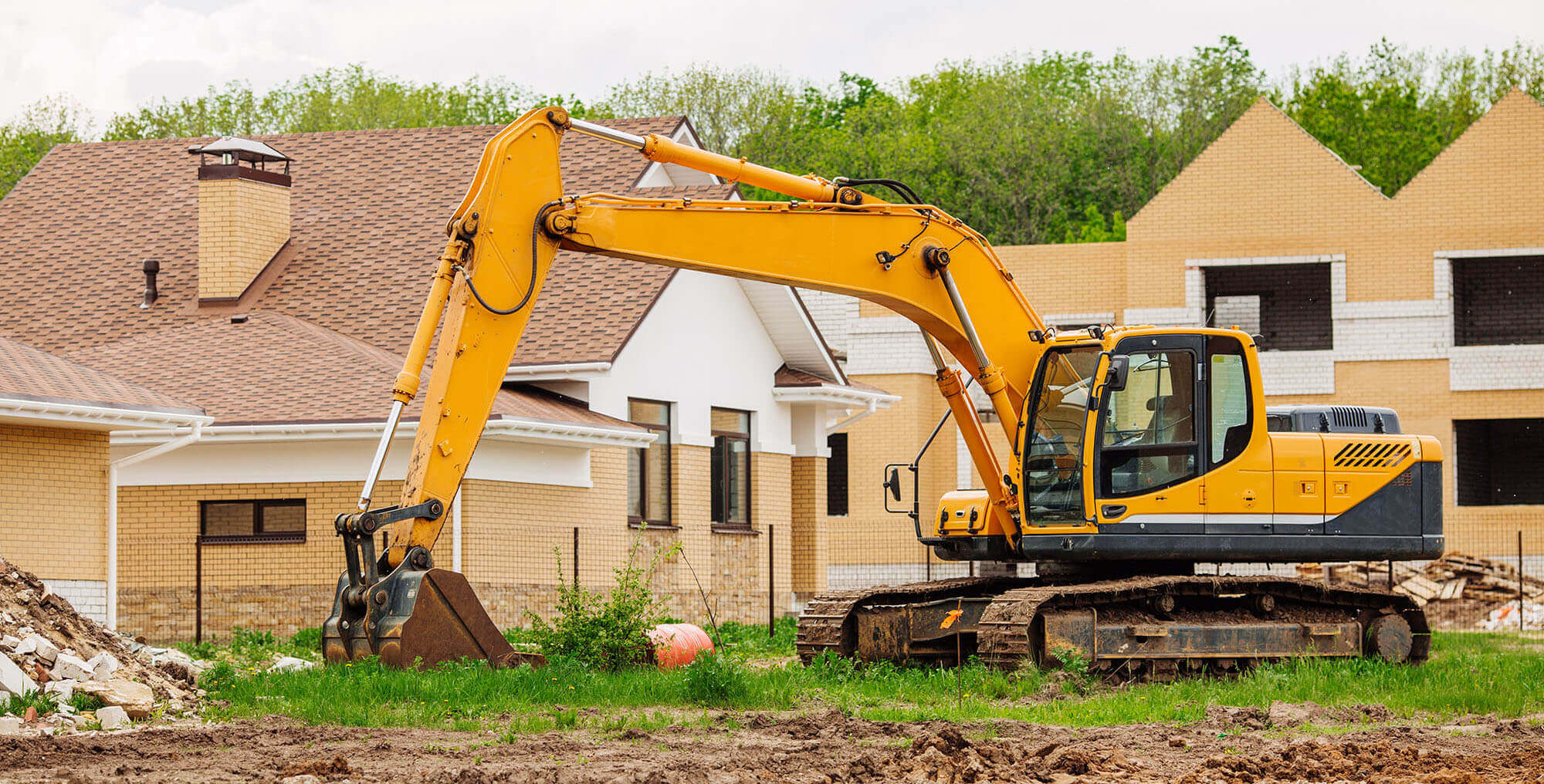 An Excavator at a Residential Work Site